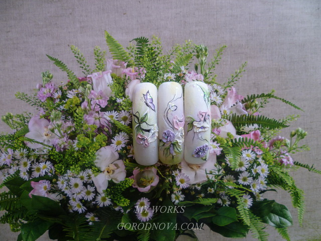 Acrylic design of nails. Florists. Flowers